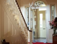 Entrance hall with a hand printed wallpaper